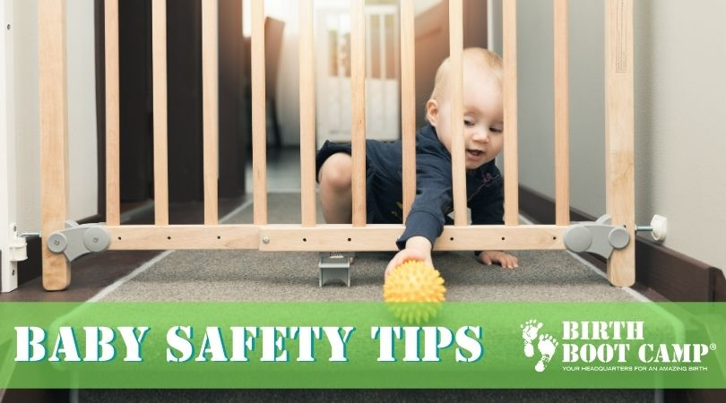 Baby reaching through baby gate for a ball - baby safety tips
