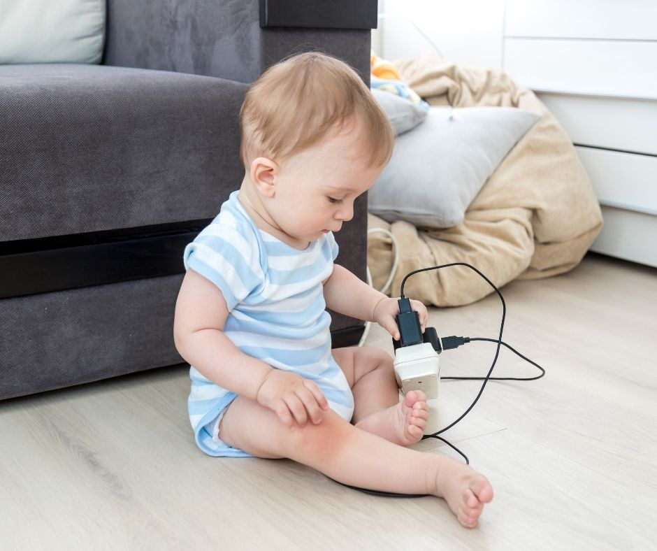 Baby playing with electrical outlet - Baby proofing