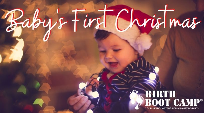Baby celebrating first christmas with christmas lights
