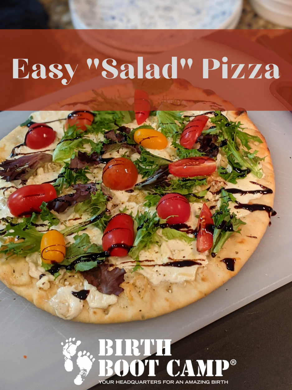 Naan bread pizza with spring mix, tomatoes, and balsamic on top